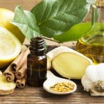 Alternative Medicine with Garlic, Ginger and Lemon Oil